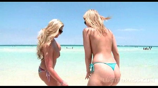 Blonde sex bombs working big butts and huge tits in the sea